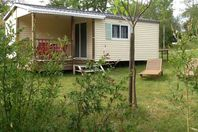 Camping Naturiste Le Champ de Guiral, Mobile home with terrace