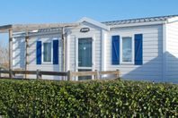 Camping Naturiste Les Aillos, Mobile Home with Terrace